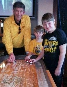 Gary Patterson and Kody playing shuffleboard at Jerseys